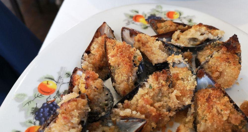 piatto della cucina pugliese, le cozze gratinate